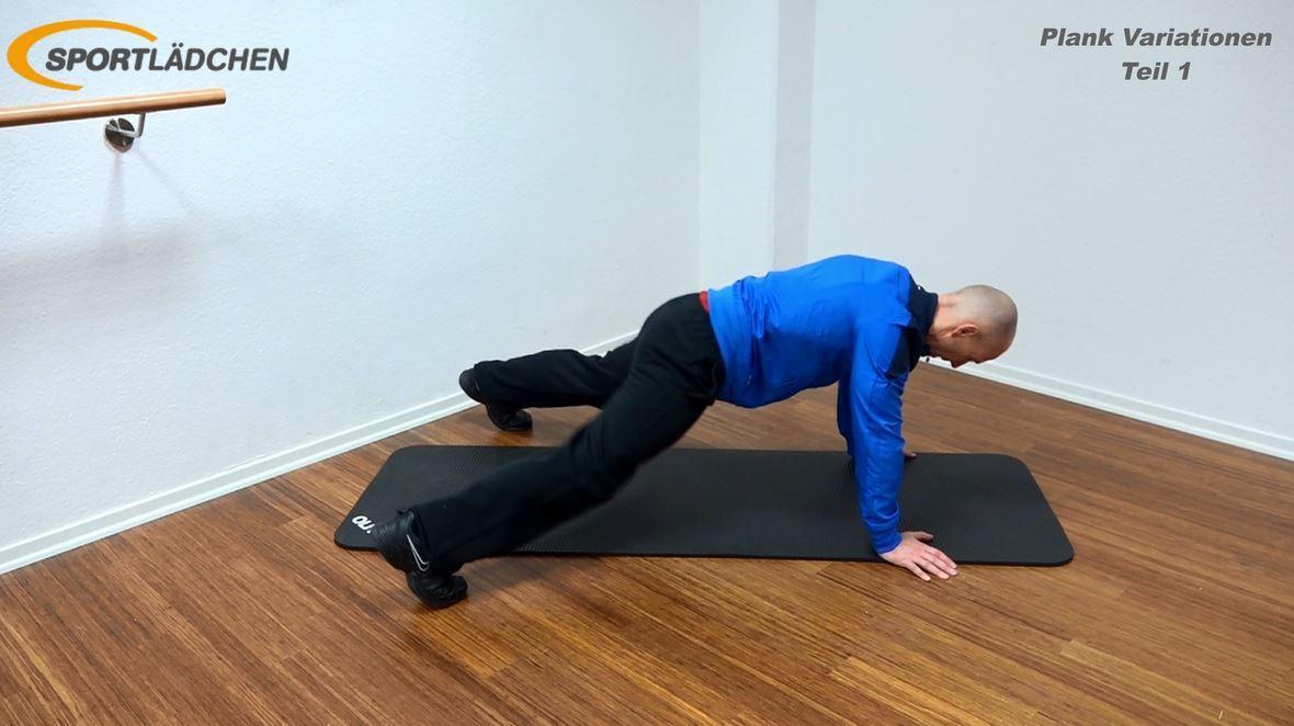 Plank Übung - Jumping Jacks in der Liegestützposition - Ende der Bewegung