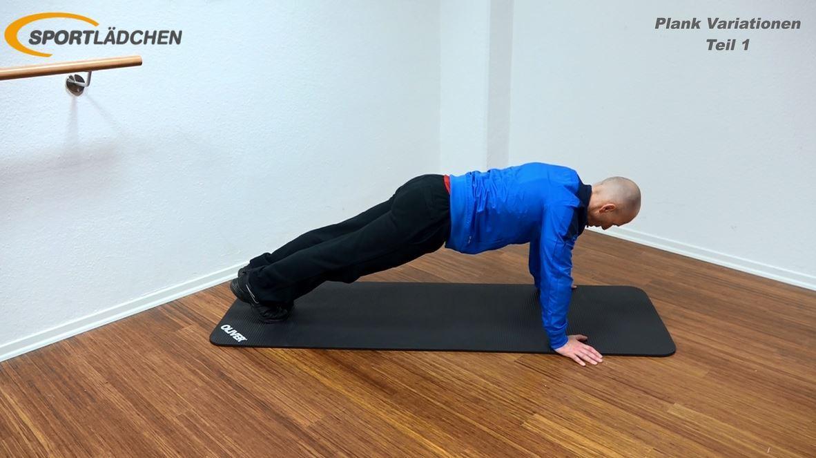 Plank Übung - Jumping Jacks in der Liegestützposition