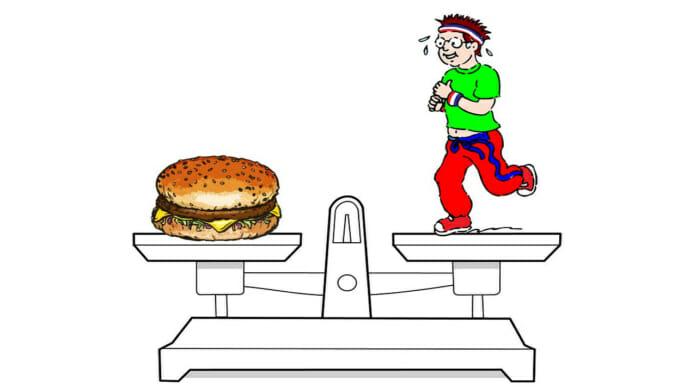 Küchenwaage mit Burger auf der einen und einer Cartoonfigur auf der anderen Seite der Waagschalen.