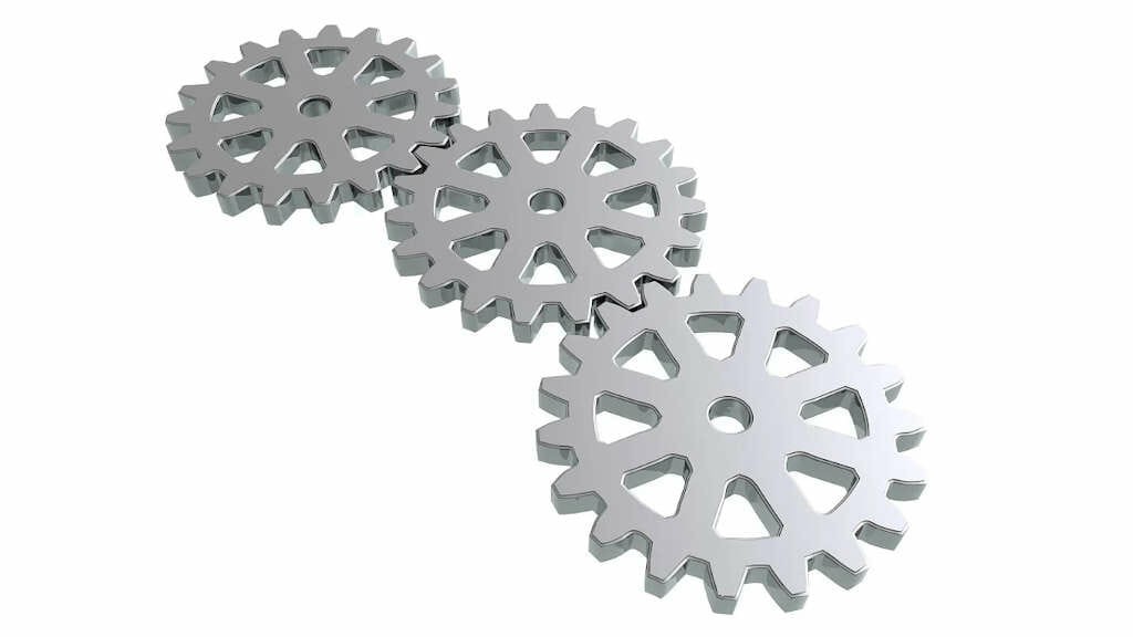 Was sind Faszien? Auf diesem Bild als illustrative Darstellung Zahnräder, die ineinander greifen.